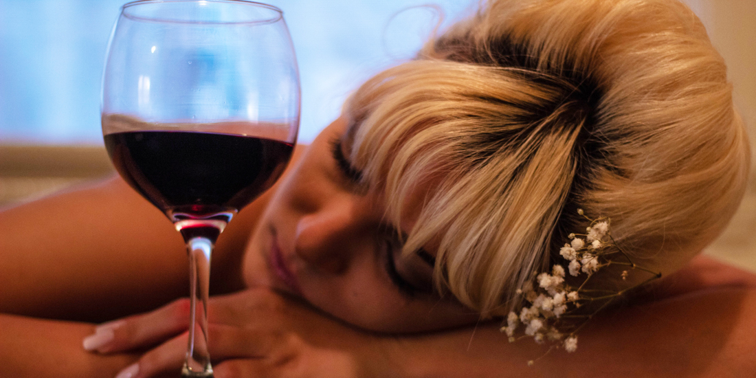 Woman with wine glas - Photo by Mahrael Boutros